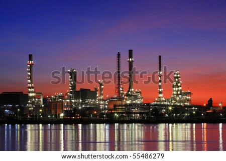 Oil refinery at twilight, Chao Phraya river, Thailand - stock photo