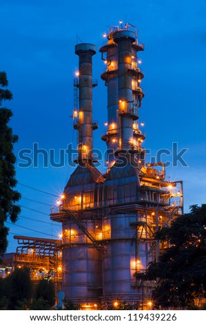 Oil refinery at twilight with blue sky