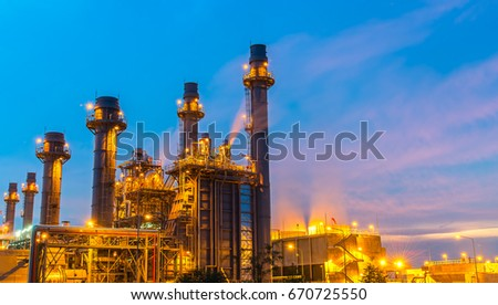 Oil refinery building plant and construction site at twilight with blue sky background #670725550