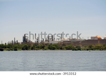 oil refinery by a park
