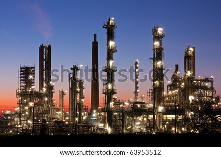 Oil refinery in Schleswig-Holstein, Germany just after sunset, petrochemical industry night scene