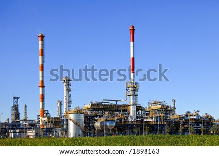 Oil-refinery, industrial-plant under blue sky.