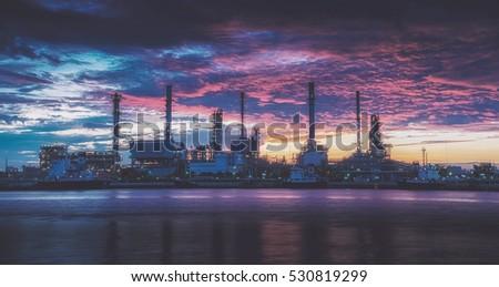 oil refinery industry plant along twilight morning. oil refinery industry reflection. oil refinery on beautiful sky.