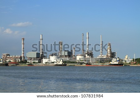 Oil refinery manufacturing with blue sky