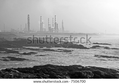 Oil refinery near the sea in a misty evening (converted to Black and White via channels)