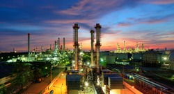 Oil refinery plant at night, The petroleum energy and petrochemical factory with column drum and pipeline construction. Gas, diesel and chemical production business industry is important for economy.