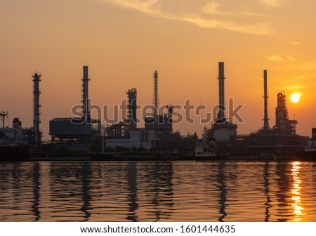 oil refinery plant of Petrochemistry industry in twilight time and reflection in near river in Bangkok, Thailand. stock photo