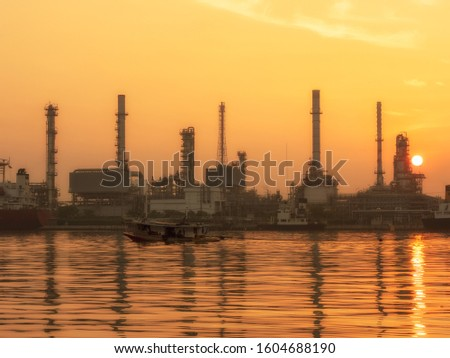 oil refinery plant of Petrochemistry industry in twilight time and reflection in near river in Bangkok  Thailand stock photo