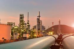 Oil refinery plant sunset, power plant on sunset, twilight background