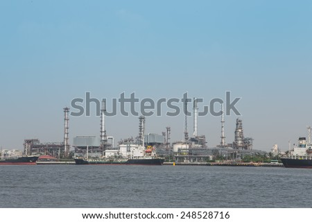 Oil refinery plant with blue sky and ship oil background