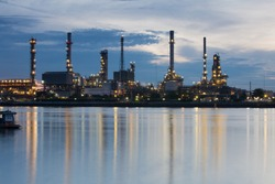 Oil refinery Riverside and Water reflection.