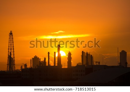 oil refinery silhouette with twilight sunset sky #718513015