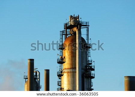 Oil refinery tower under the blue sky in the suburb of edmonton, alberta canada