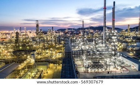Oil refinery.With a background of the city.The factory is located in the middle of nature and no emissions.The area around the air pure.business logistic.Aerial view.Top view.Light of the evening sky.