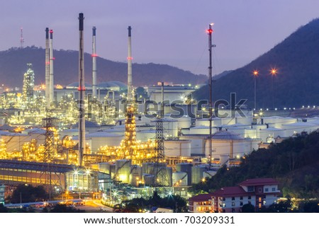 Oil refinery with tube and oil tank along night sky at Si Racha District, Rayong Province, Thailand #703209331