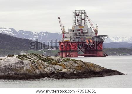 Oil rig in norwegian fjord  landscape