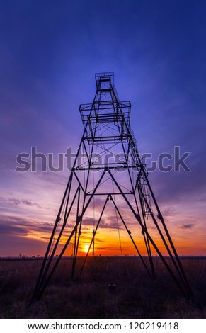 Oil rig profiled on beautiful evening sky