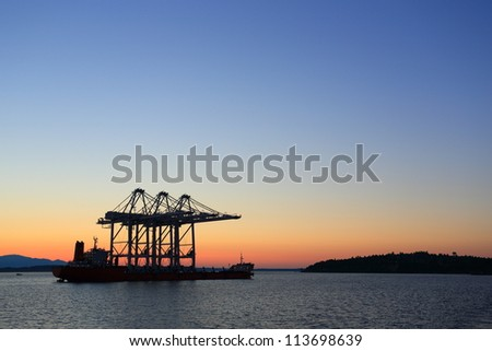 Oil rig ship in the ocean during sunset