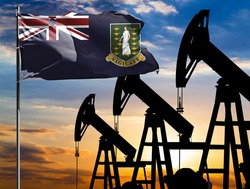 Oil rigs against the backdrop of the colorful sky and a flagpole with the flag of British Virgin Islands. The concept of oil production, minerals, development of new deposits.