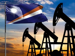 Oil rigs against the backdrop of the colorful sky and a flagpole with the flag of Marshall Islands. The concept of oil production, minerals, development of new deposits.