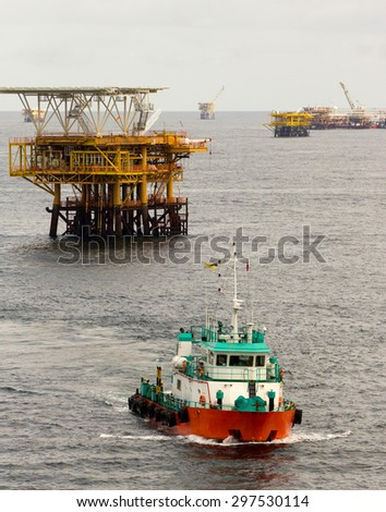 Oil rigs and a transportation vessel in the South China Sea