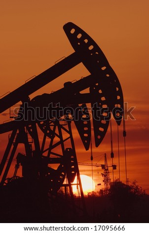 Oil rigs silhouette over orange sky-9