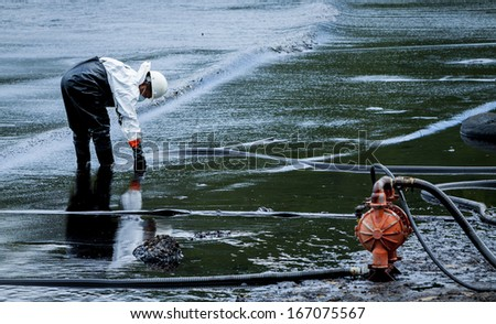 oil spill cleanup at koh samet thailand