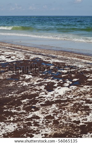 Oil spill on Gulf Coast beach from a leaking offshore well.