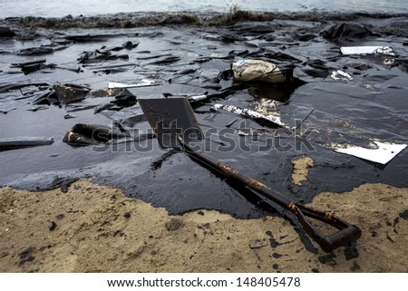 Oil stained on the beach at Ao Prao Beach, Koh Samet, Rayong, Thailand  - stock photo