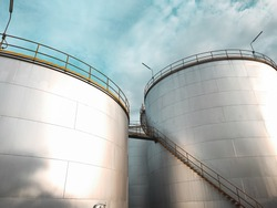 Oil storage tank In industrial areas. Crude oil storage plant For export. Palm oil factories in Asia. The atmosphere at sunset. Within the industrial plant
