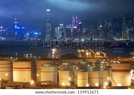 Oil Storage tanks with urban background in Hong Kong - stock photo