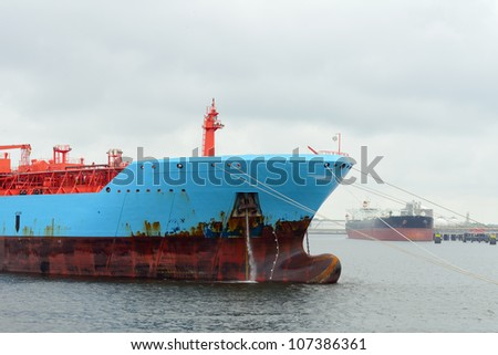 oil tanker and gas ship in the harbor of rotterdam