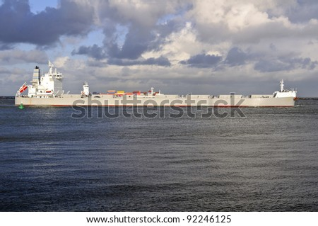 oil tanker and pilot boat assist coming in the harbor of rotterdam netherlands