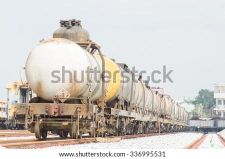 Oil tanker cars on the railway cargo station