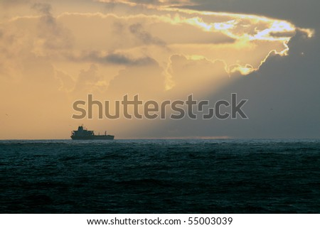 Oil tanker cruising the portuguese coast at dusk