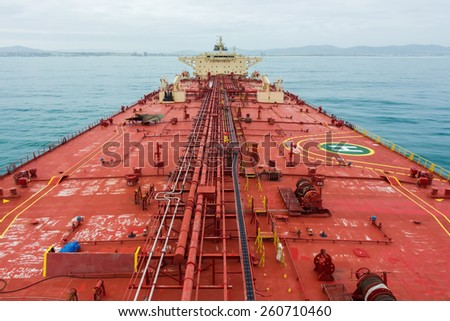 Oil tanker deck while calm weather. View from masthead.