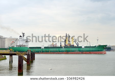 oil tanker sailing out of the harbor of rotterdam