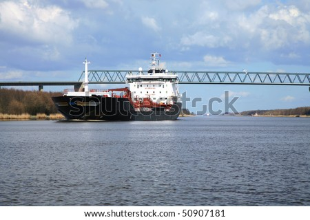 Oil tanker. Ship with cargo on the Kiel Canal, Germany. - stock photo