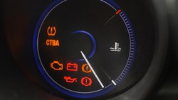 Oil Temperature Gauge and Indicator Lights of Starting and Stopping Car Close Up