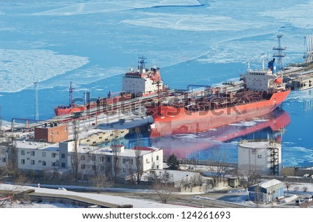 Oil terminal a ship with cargo of oil in the winter in the ice, the port of Nakhodka, Russia