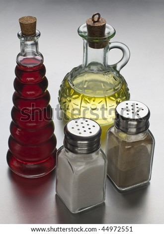 Oil, vinegar, salt and pepper close up shoot