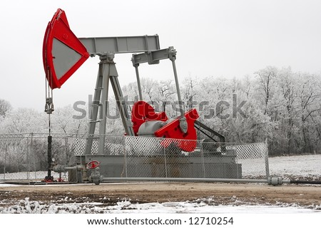 Oil wall on a pale winter landscape