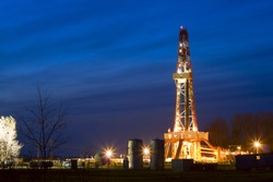 Oil well at night, lighting the outdoors.