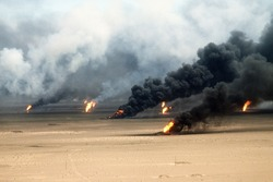 Oil well fires rage outside Kuwait City in the aftermath of the First Gulf War. Retreating Iraqi troops set fire to Kuwait's oil fields. Mar. 21 1991.