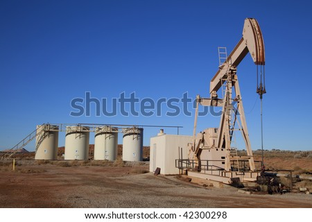Oil well with Storage Tanks in the tackground