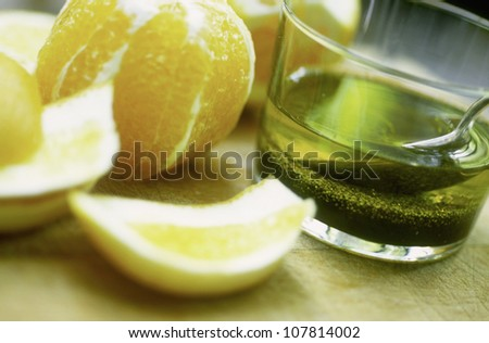 Oil with mustard seeds and orange and lemon juice