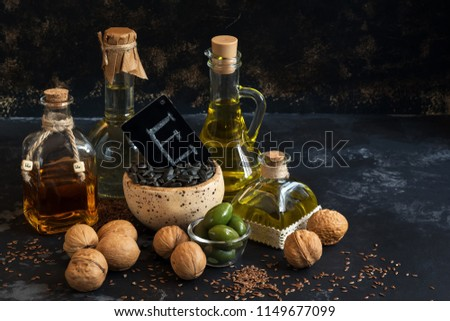 Oil with vitamin E. Linseed oil, olive , sunflower , walnut . Selective focus. Concept