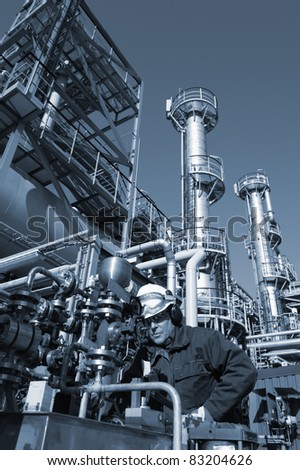 oil worker inside oil and gas refinery, blue toning idea