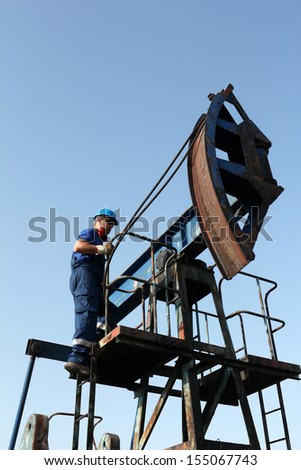 oil worker on pump jack