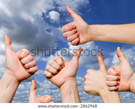 OK gestures against the blue sky